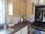 Well equipped kitchen with oven, hob, microwave, kettle, toaster and extractor fan