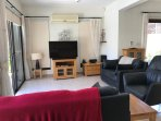 Large open plan lounge with cable TV, WIFI, Air con, DVD's and comfortable leather chairs.