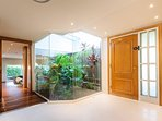 Entrance hall with covered courtyard and a beautiful tropical garden