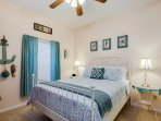 The blue ocean themed bedroom features a queen sized bed...