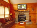 Great Room has wood burning fireplace. Large Flat screen TV with DVD player and Comcast receiver