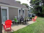 Back patio w/BBQ grill overlooks golf course fairway