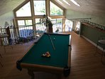 billiard table in the loft that overlooks great room, the back patio & yard and Lake Michigan.