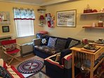 Sunny front room with large movie collection and pull out full sofa sleeps 2, with ceiling fan /AC