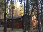 Rear view ranch cabin with all amenities all on one level.