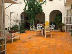 Central patio with Mexican clay floor and classic arches