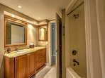 The pristine bathroom offers a shower/tub combination, where you can wash off to prepare for each exciting day!