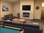 Electric fireplace, vaulted ceiling,  and 60 inch TV.