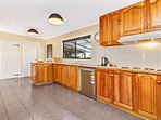 Large country kitchen with full size fridge, dishwasher, electric stove top and oven
