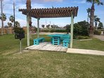 One of 3 BBQ grills and picnic tables