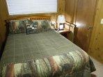 Queen bed in lower bedroom.