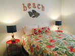 bedroom with beach sign