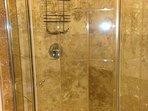 Hallway Bathroom Glass Shower With Travertine Tile