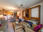 2 Twin Murphy Beds In The Living Room Area