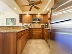 Kitchen Area With Stainless Steel Appliances And A Convection Ov