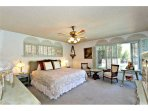 Master Bed - has view of the spa, pool, and the golf course