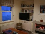 Winter view of sitting room and views of sea at high tide