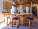 Kitchen bar seating accommodates 3
