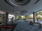 Gymnasium equipped with full set fitness tools.