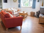 Lounge area with 48'' smart TV and logburner is very cosy.