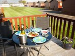 Dine on the decking - plenty of seating for 6 with table and large sun parasol.  Views to the river