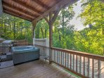 Admire gorgeous views of the surrounding foliage  from the private hot tub.
