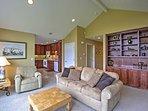 An elegant bookshelf highlights the living room.