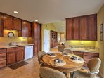 Sit down at the wood dinette table, uncork a bottle of wine and share your home-cooked goods for casual vacation dining...