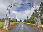 An arched entryway and long, private driveway brimming with trees lead you to your peaceful McMinnville destination.