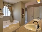 The spa-like en suite master bathroom has a large soaking tub.