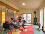 Kick back on the modern leather furniture while you enjoy all of the channels on the flat-screen cable smart TV in the...