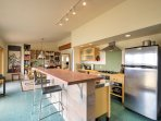 Prepare all of your meals in the full kitchen which features beautiful butcher block counters and new stainless steel...