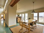 Dine inside at the large dining room table situated next to the large south-facing windows.