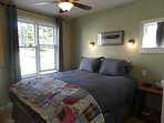 Bedroom with queen bed, quality linens, and a handmade quilt.