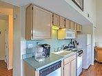 The fully equipped kitchenette features a 4-burner stovetop, oven and counter space for chopping.