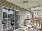 Take your drink outside and sit underneath the ceiling fan in the covered patio.