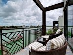 Master bedroom balcony has seating for 2 guests and beautiful view.