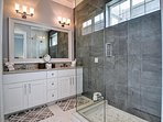 Master bathroom has walk in shower and vanity with double sinks