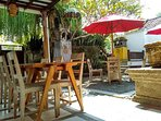 House Restaurant serves ' home - cooked meal' set at the front yard of the host [ Wayan ] family hou