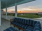 Expansive second and third floor decks with sunset views over Galveston Bay.