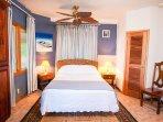 North guest bedroom with queen bed and en-suite bathroom