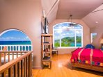 Master Bedroom Suite surrounded by walls of glass overlooking the Caribbean Sea.