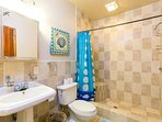 One of the two tiled bathrooms