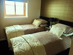 The king sized bed can be split into twin beds. Please request at time of booking.