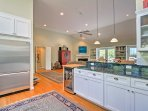 With stainless steel appliances and ample counter space, cooking for 6 is effortless in this kitchen.