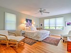 The master bedroom boasts a cozy queen bed, flat-screen TV and private en suite bathroom.