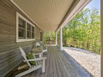 Admire the towering trees that surround the property from this lovely front porch.