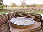 Private sunken hot tub by day or night, perfect to relax and unwind