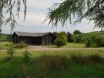 Nestled in 7 acre private grounds with woodland, beck, pond and open spaces, views & wildlife abound