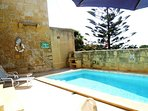 GUNO holiday house pool area with barbecue